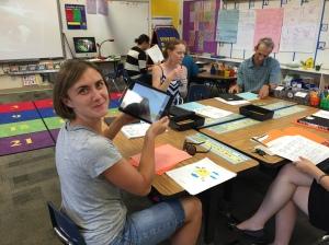 Parents in classroom taking selfies